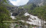 Picture taken from Valley of Flowers entry gate. You can see lot of snow and a beautiful waterfall in the background.
