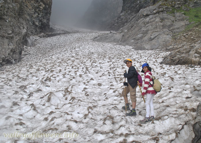 Me and My sister crossing a Glacier on the way to Valley of Flowers