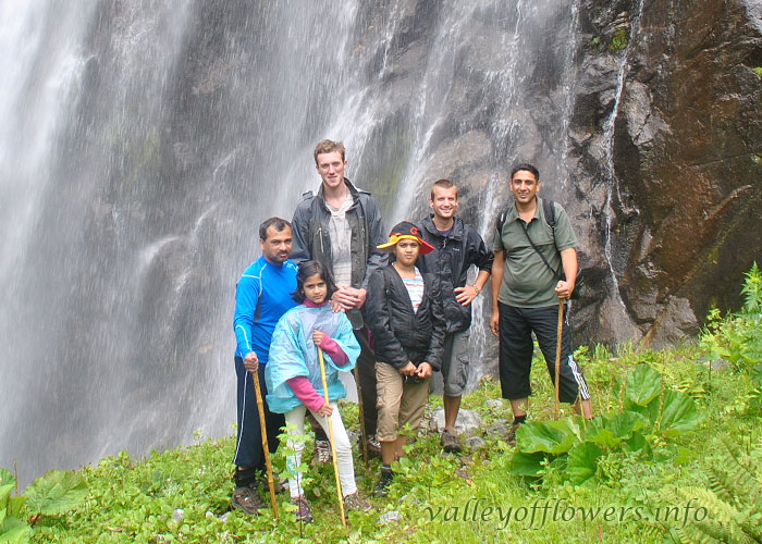 My family, Rui, Edward and Devkant Uncle near a waterfall at the entrance to Valley of Flowers